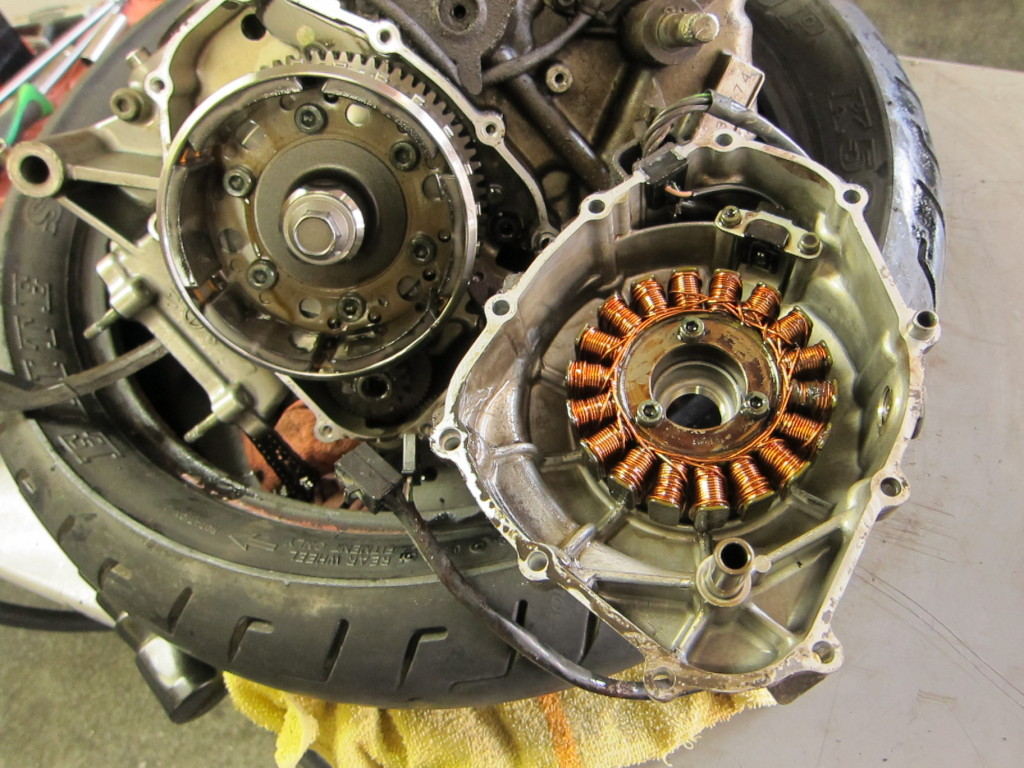 Stator cover, pulled, showing stator coils on right and flywheel on left