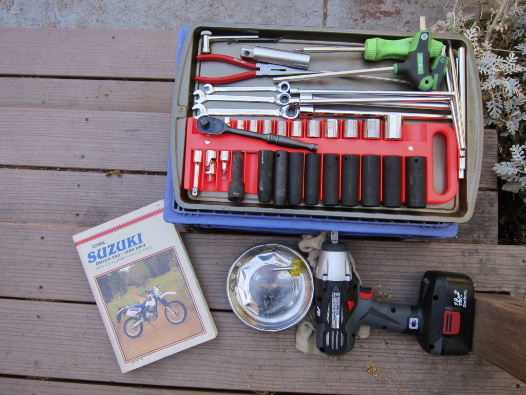 Tools, manual and supplies, laid out for action