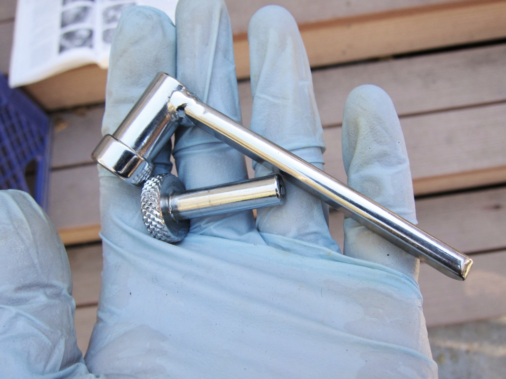 Motion Pro valve adjustment wrench--the small knurled section fits over the adjuster, and slips into the outer wrench, which loosens the locknut