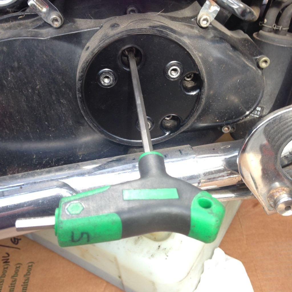 Removing allen bolts from the inner oil filter cover